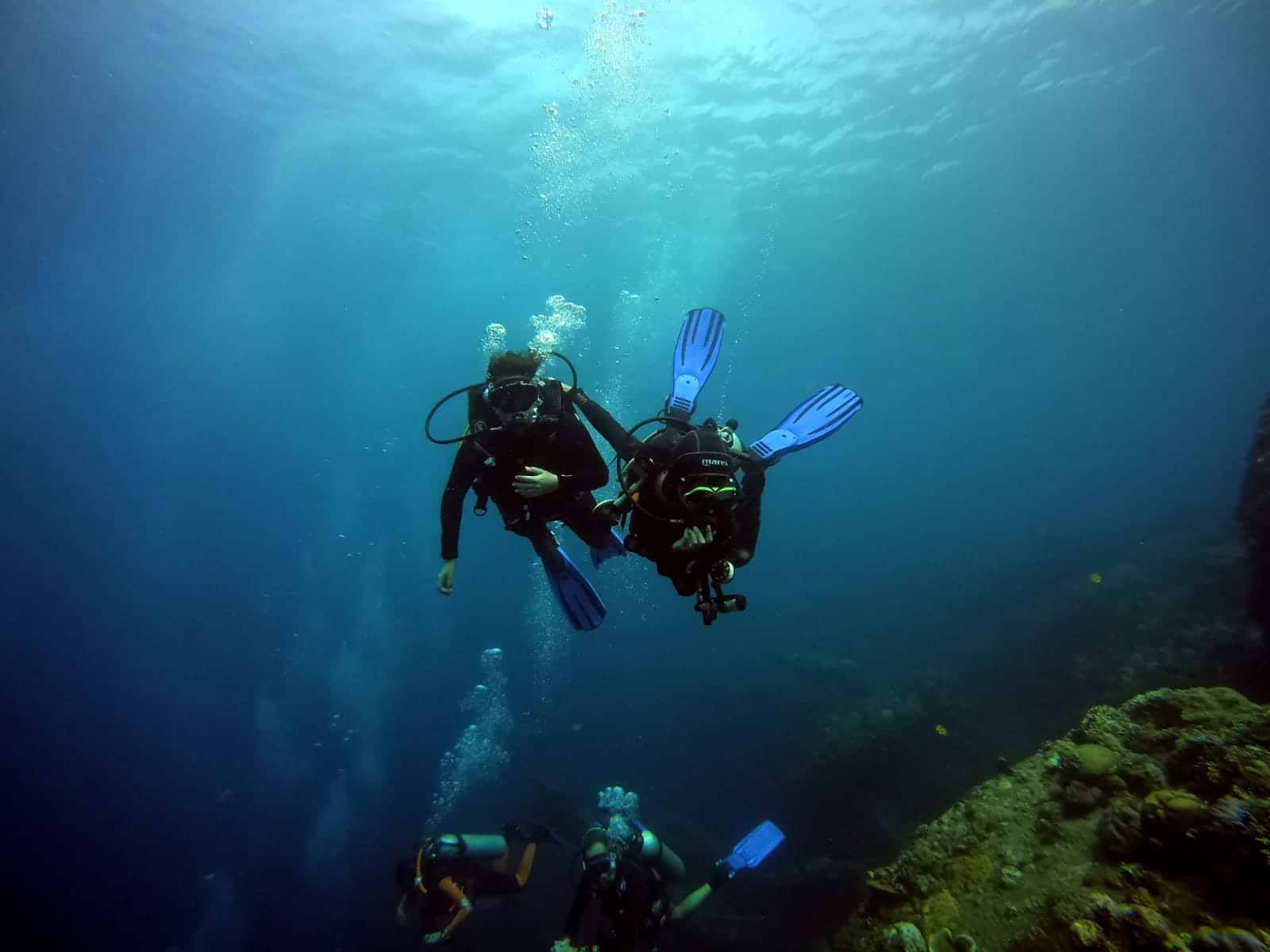 Family diving ship wreck