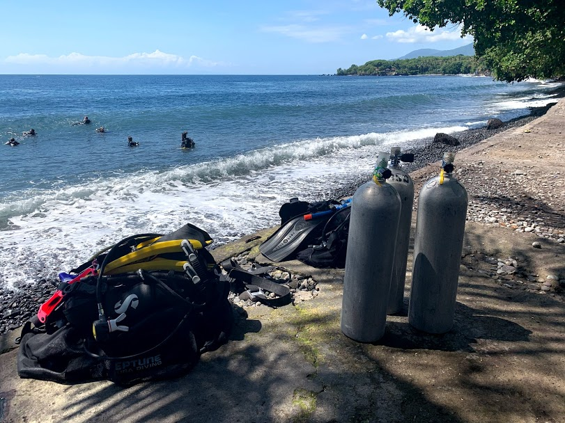 Scuba diving equipment sitting near the beach before a dive.